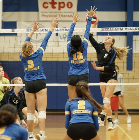 Senior Grace Werkenthin spikes the ball in the Knights 3-1 loss to the Anderson Trojans at Don Caldwell Gymnasium. The loss was  Macs first district setback. The Knights are now in third just behind Anderson and Ann Richards and will face the Trojans again on Oct. 8 at Anderson High School.