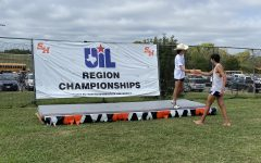 Senior Thomas Melina Raab greets fellow 5A state qualifier Antonio Sanchez of Hendrickson (who finished 14th and claimed the penultimate qualifying spot) on the podium at Kate Barr Ross Park in Huntsville.