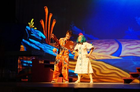 The SpongeBob Musical cast members Finn Higginbotham (Larry the Lobster) and Alice Scott (the mayor of Bikini Bottom) perform a scene together. Higginbotham had to assume the role of Larry the Lobster after Salem McFadden sprained their ankle on opening night.