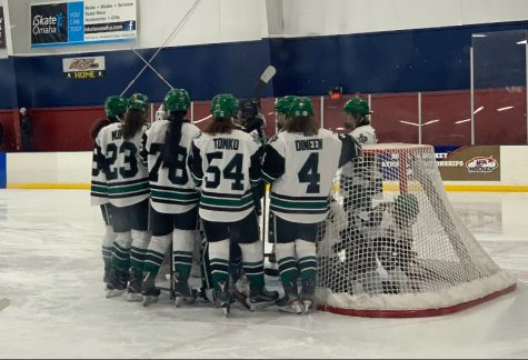 Sophomore Meghan Tomko talks with her teammates at a recent practice. Most of her teammates live near the ice rink in Dallas but Tomko refuses to let the commute impede her from playing competitive hockey.