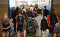Students flood the hallways on the first day of school. With 1,829 students and a main building capacity of 1,596, students find themselves in close quarters.