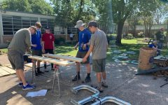 Volunteers from Braden Roeders Boy Scout troop help to build a bench for the English courtyard.